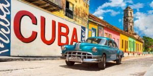 Vintage car and mural- Cuba