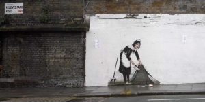 Regents Park Rd Camden London-graffiti attributed to Banksy