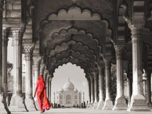 Woman in traditional Sari walking towards Taj Mahal