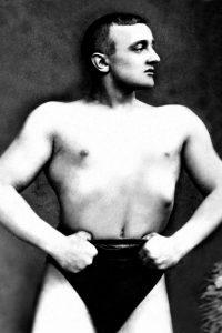 Bodybuilder with Thumbs Tucked in Belt