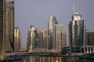 UAE, Dubai Tower lights reflect on marina water
