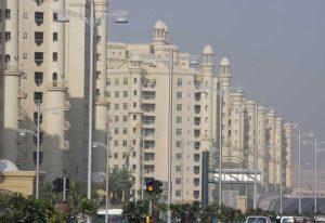 UAE, Dubai Apartment buildings next to main road