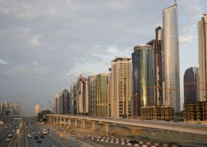 UAE, Dubai Jumeirah Lake Towers beside a Road