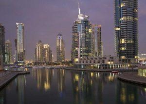 UAE, Dubai, Marina Lights reflect on marina