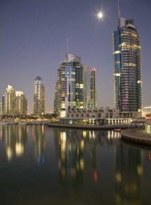 UAE, Dubai, Marina Towers reflect on marina