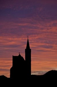 Namibia, Luderitz Church silhouetted by sunrise